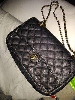 Black quilted bag.. price negotiable make offer Thumbnail