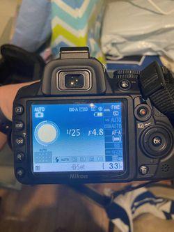Nikon D3100 with multiple attachments Thumbnail