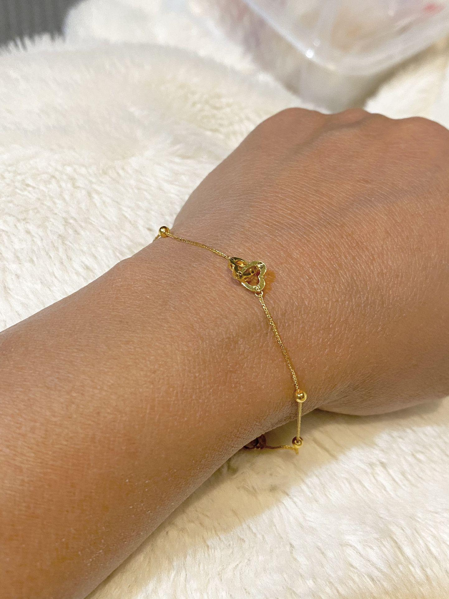 Real 18k Saudi gold double heart bracelet