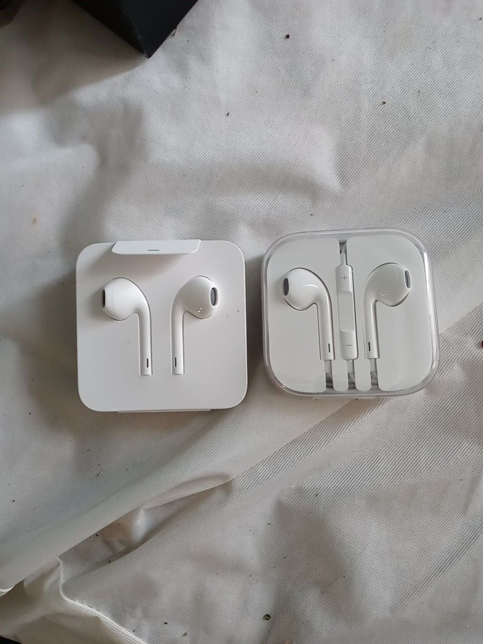 2 sets of Apple ear buds iphone and iphone 5 s