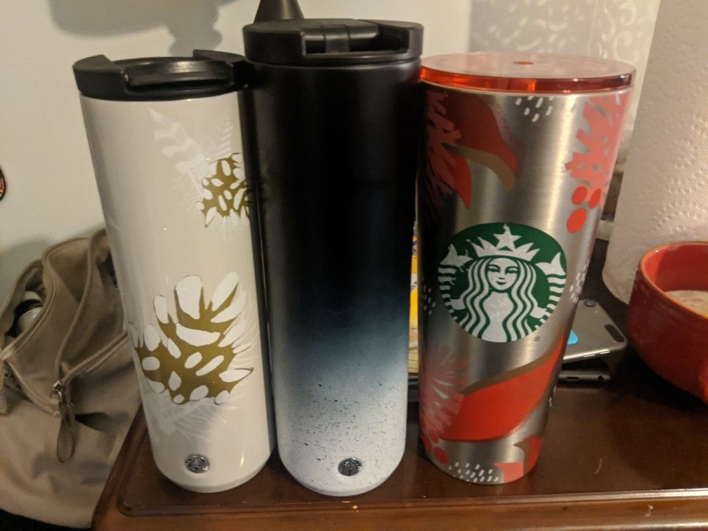 Starbucks tumblers.. Solid Black One Is Sold