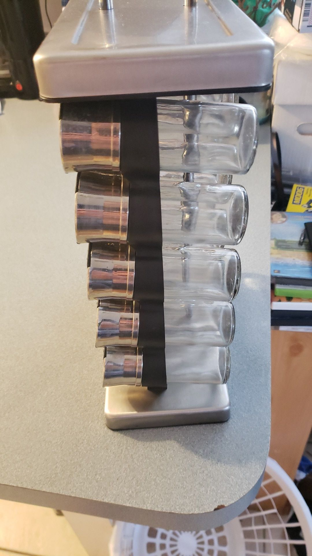 Spice rack with labeled glass jars