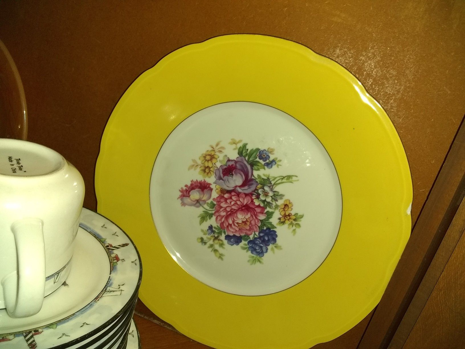 Variety of decor plates n lighthouse dishes