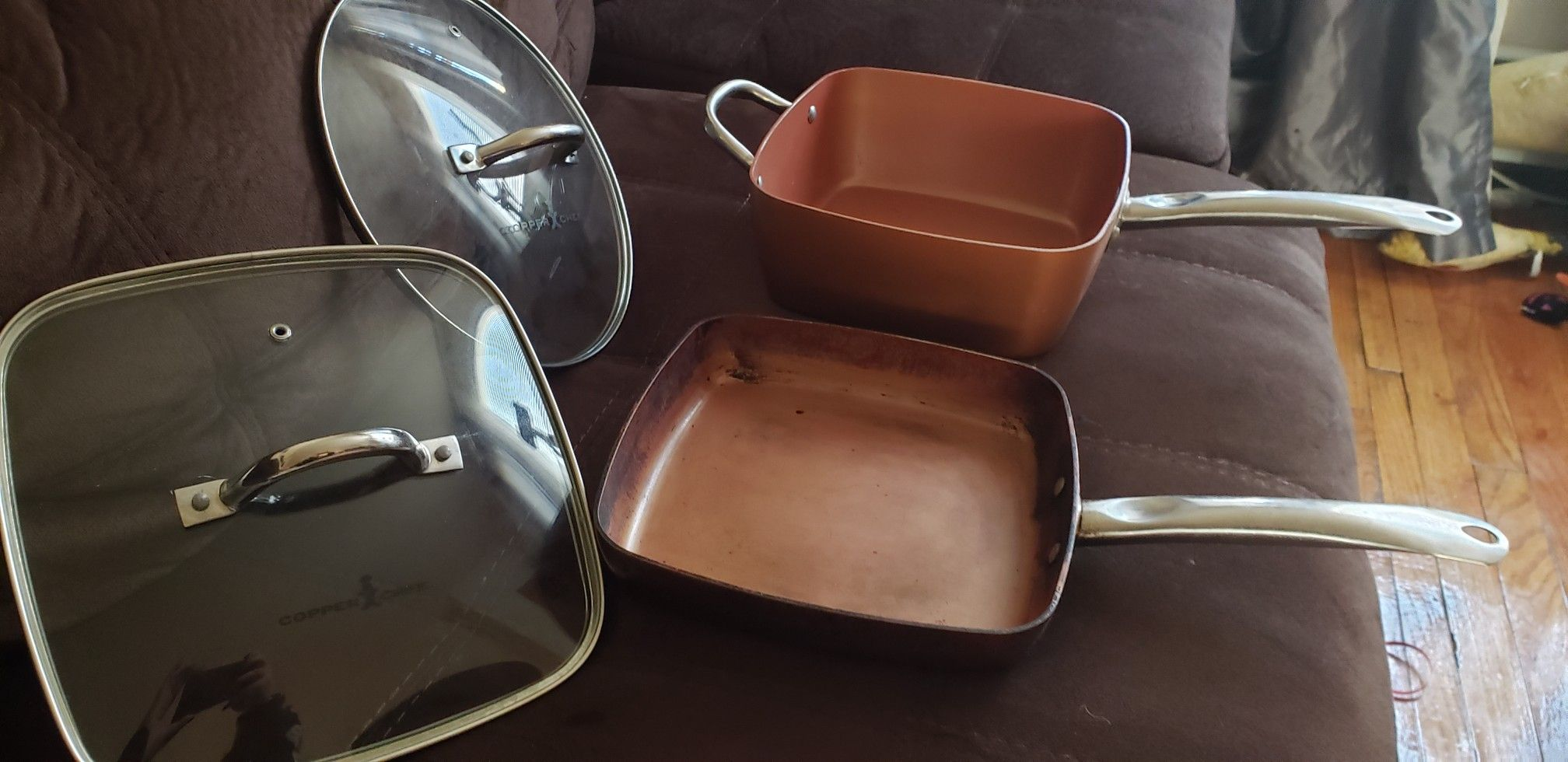 COPPER CHEF FRYING PAN ,DEEP SQUARE HOLDS 4.5 QUART PAN POT, 2 LIDS COOK OVER GAS, ELECTRIC I WOULD ALSO PUT THEM IN THE STOVE WITHOUT LIDS.