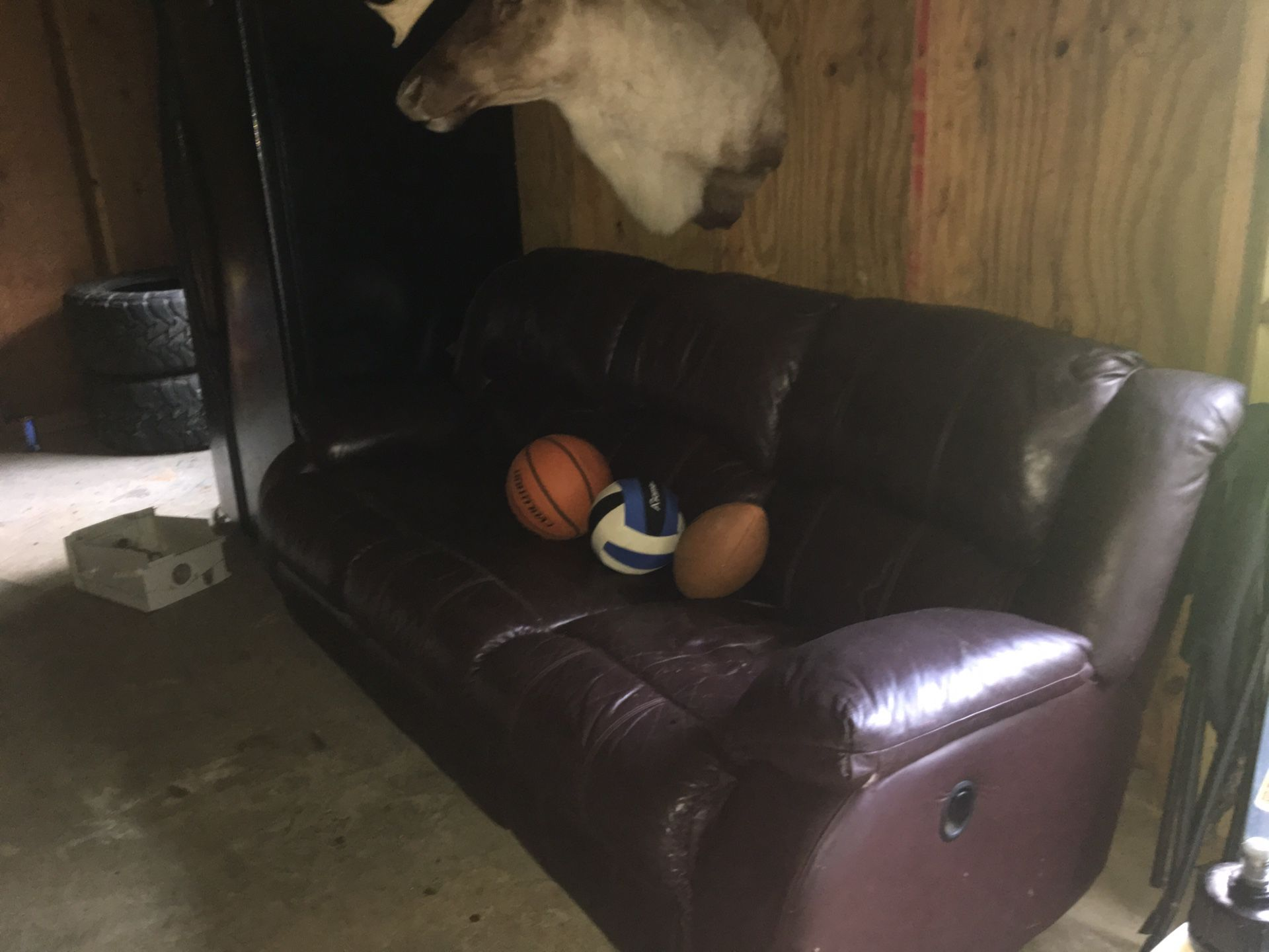 Real leather sofa with recliner on each end
