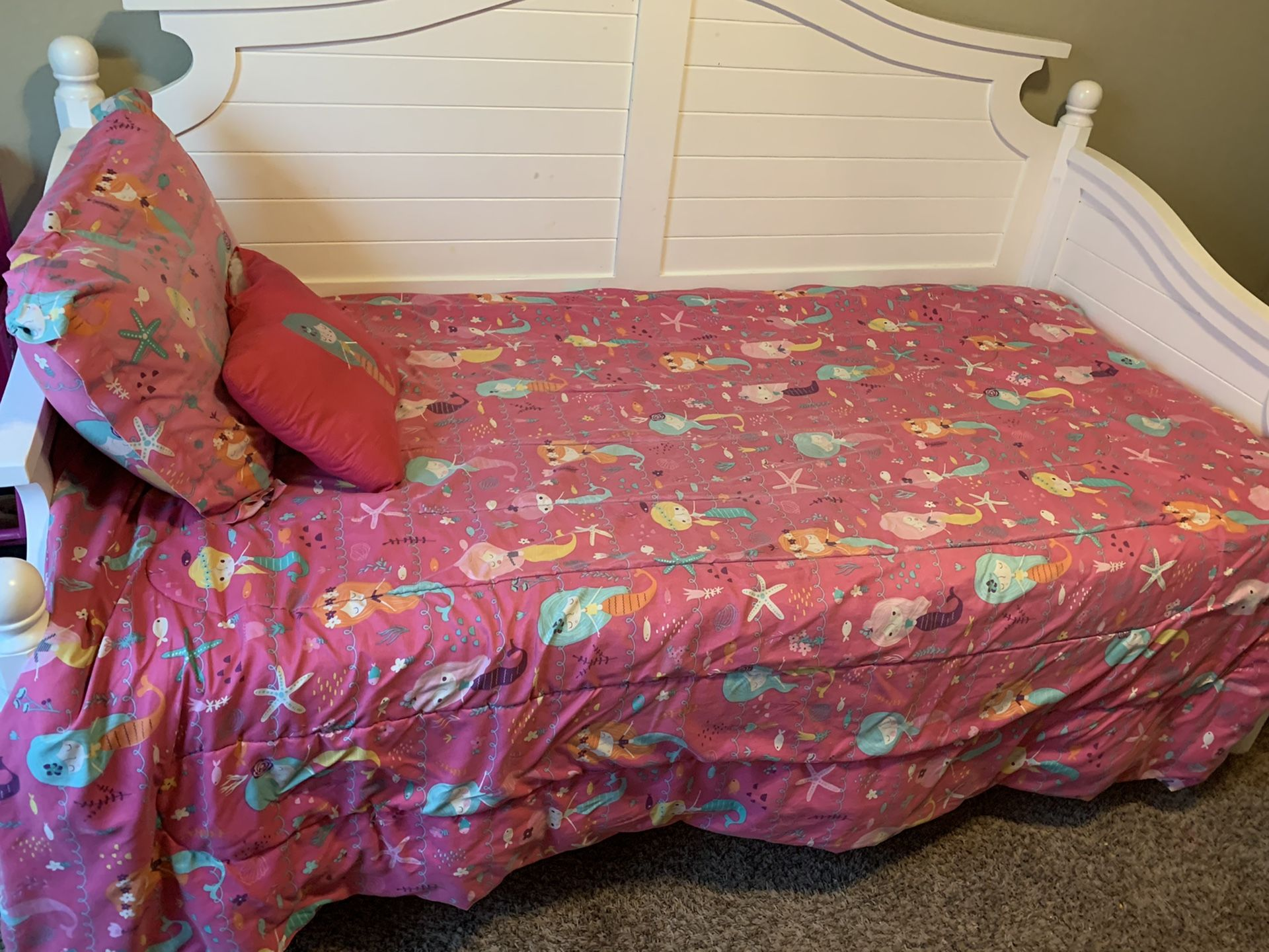 Mermaid decor and comforter set with sheets and two curtain sets.