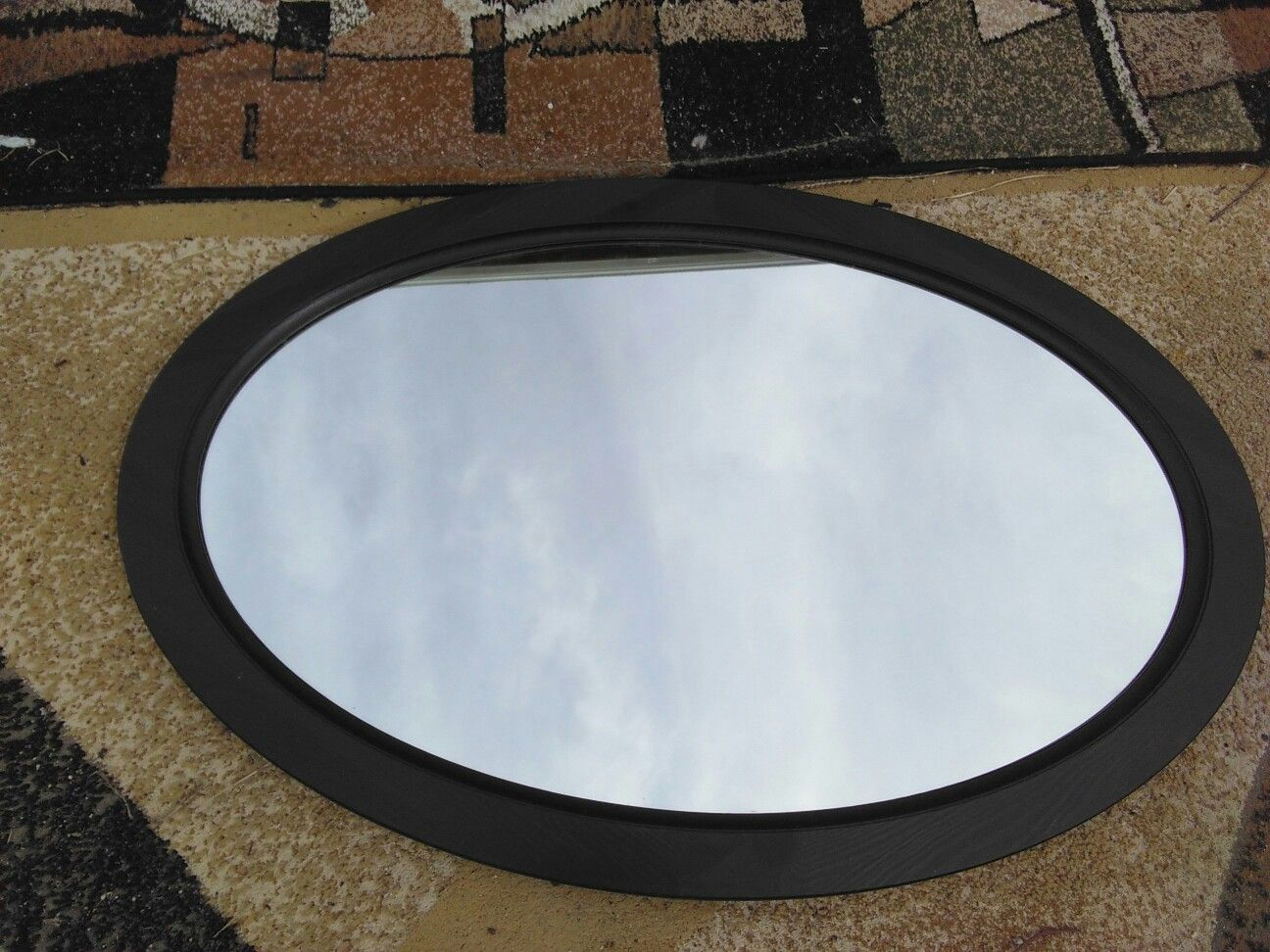 Mirror in Oval Frame.