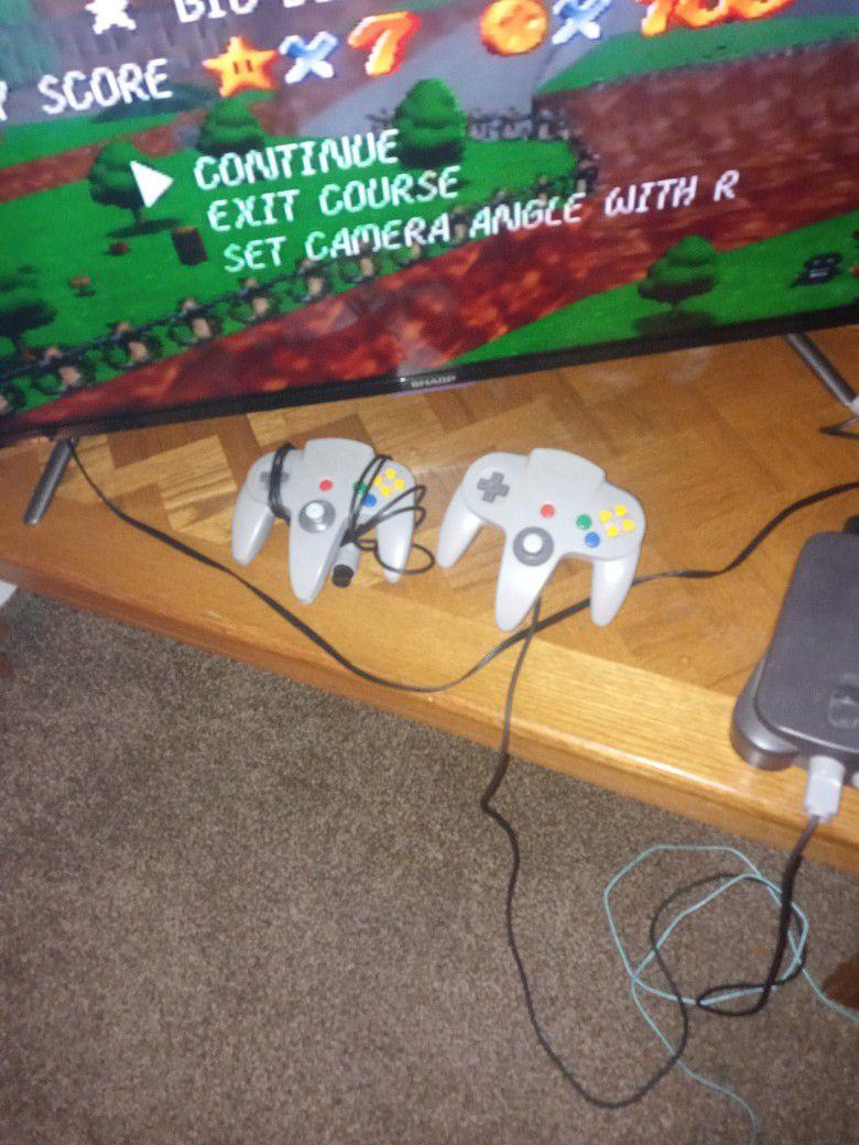 Nintendo 64 Console, Controller, And Games