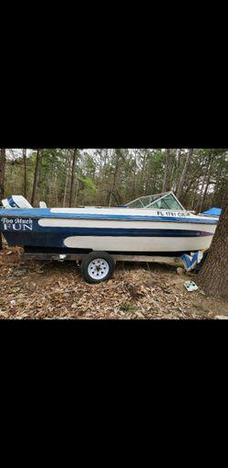 Evinrude motor and boat Thumbnail