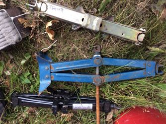 Gas can lot, tow straps, car jacks, trailer tires(2), tow hitch Thumbnail