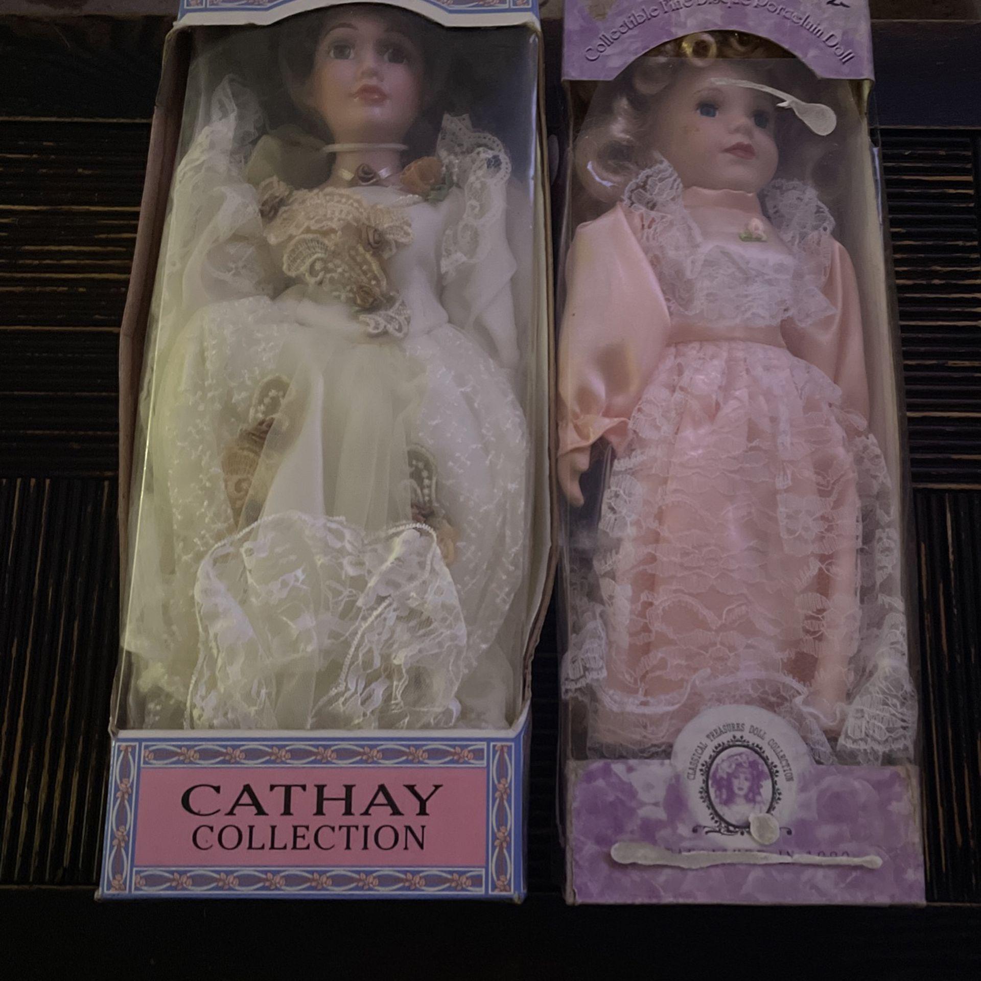 2 Porcelain Dolls
